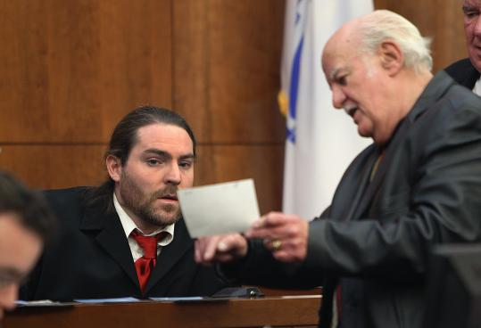 David Fitzgerald showed a photo to his neighbor Courtland Harlow on the witness stand in a harassment hearing in Plymouth District Court last month. A year-old state law has made such cases possible.