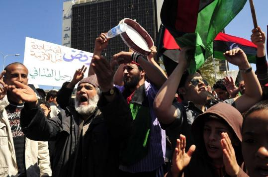 Protesters took part in an anti-Khadafy demonstration outside the hotel in Benghazi where mediators from the African Union were meeting yesterday with Libya's rebel leadership.