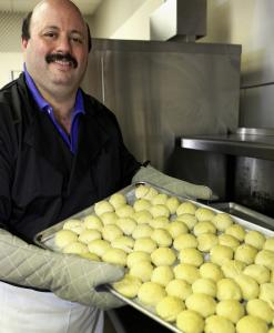 Todd Levine cooks up matzo balls for the deli's own chicken soup.