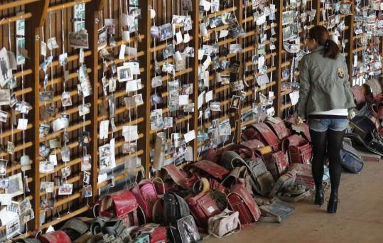 A woman looked for her belongings at a center for items found after the earthquake in Japan.