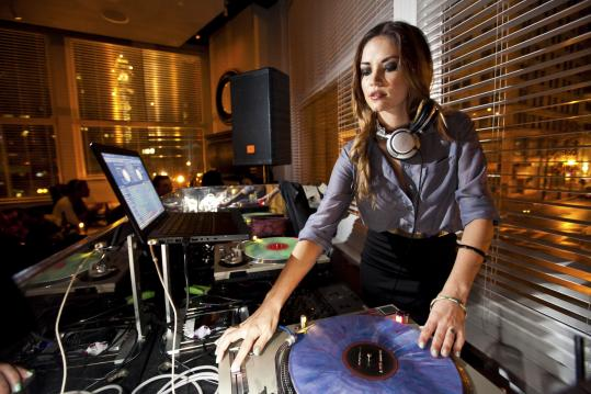 Beth Ladew spins under the name DJ Ms Thang during her Friday-night residency at Woodward at Ames hotel.