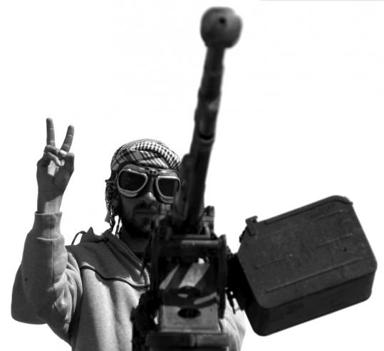 A Libyan rebel flashes the victory sign in the eastern town of Ajdabiya. Getty Images