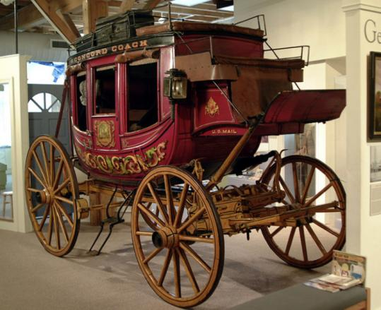 An original Concord Coach, horse-drawn and big enough for nine passengers, at the Museum of New Hampshire History.