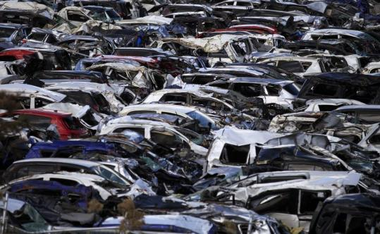New vehicles damaged by the March tsunami in a Toyota lot in Sendai, Japan.