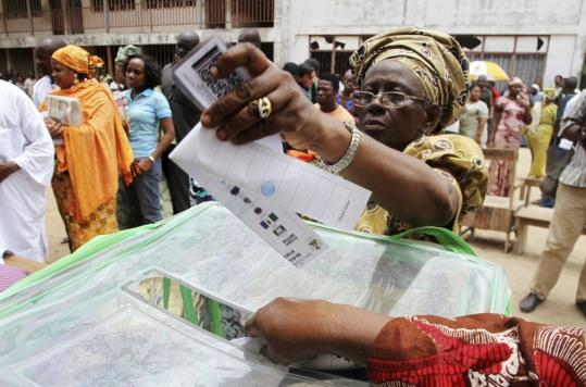 In Lagos, a woman casts her ballot during the presidential elections yesterday. Nigerians were hoping for a credible election unmarked by the violence and fraud of the past.