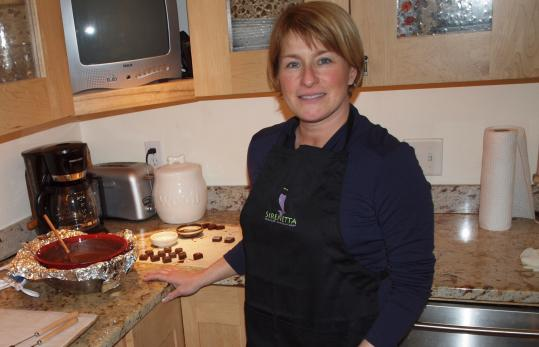 Scituate resident Danielle Verzone uses the kitchen of her 1844 farmhouse to concoct chocolates for her home-based business.