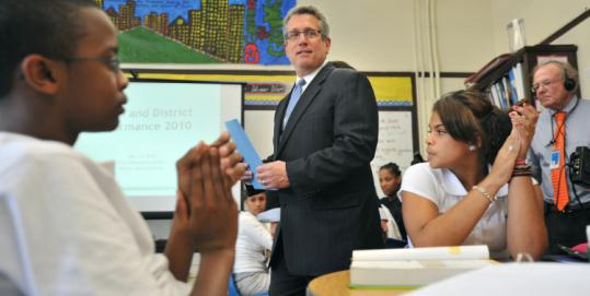 Mitchell Chester, shown during a visit to the Eliot School in the North End, said the goal is to fix a long-broken evaluation system that too often fails to provide constructive feedback.