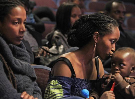 Cousins Emma Uinodukunda and Gabriella Mukakabano, with son Anthony, at yesterday's commemoration.