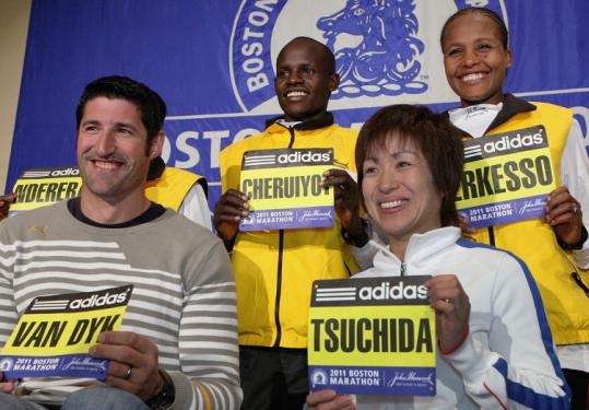 DEFENDING CHAMPIONS — Wheelchair racers Ernst Van Dyk and Wakako Tsuchida, along with Robert Kiprono Cheruiyot and Teyba Erkesso, are happy to receive their bibs at the Fairmont Copley Plaza Hotel yesterday.