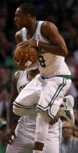 Rajon Rondo pulls down a second-half rebound, one of nine he had in the game.
