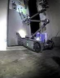 A radio-controlled iRobot PackBot is shown opening a door at the Fukushima Daiichi power plant yesterday in Japan.