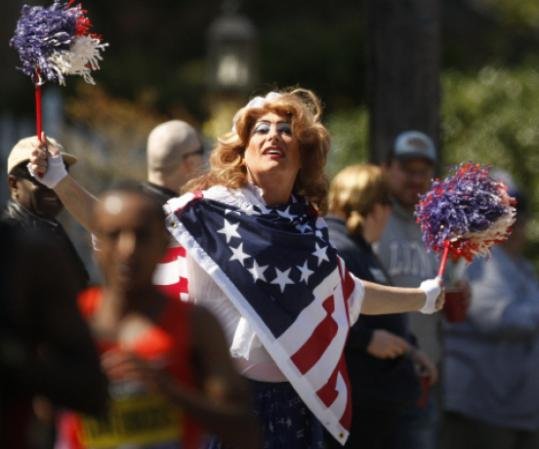 A man dressed as a woman in patriotic colors cheered along the Marathon route in Natick.