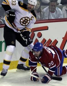 Montreal's James Wisniewski tries to draw a penalty in the first period on the Bruins' Zdeno Chara, to no avail.
