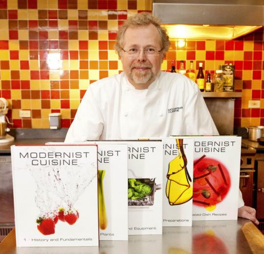 "Author Nathan Myhrvold with his multiple-volume, 2,438-page ""Modernist Cuisine,'' about avant-garde cooking."