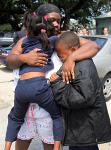 Evette Davis hugged her daughter and son after a gun fired at a Houston elementary school yesterday.