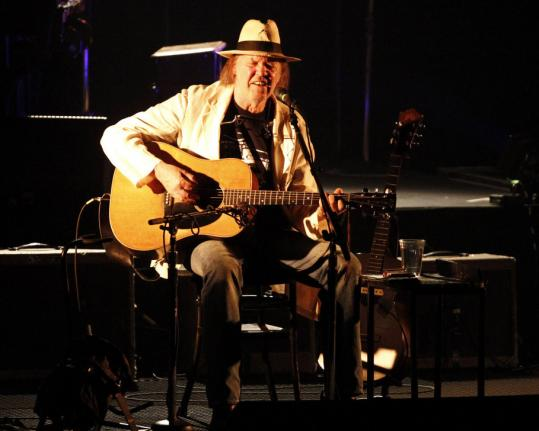 With acoustic and electric guitars, two pianos, and a pipe organ, Neil Young mixed new songs in with his classics last night.