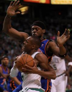 Celtics guard Rajon Rondo drives past New York's Bill Walker on his way to scoring 2 of his team-high 30 points.