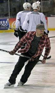 Trading his goaltender's attire for street clothes, the Bruins' Tim Thomas takes a brief spin around the ice at the US Olympic Training Center in Lake Placid, N.Y.