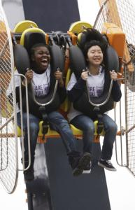 "Corrlena McKelvey, 16, and Binta Li, 14, tried out the ""Zenobio,'' one of four new Coney Island rides, yesterday."