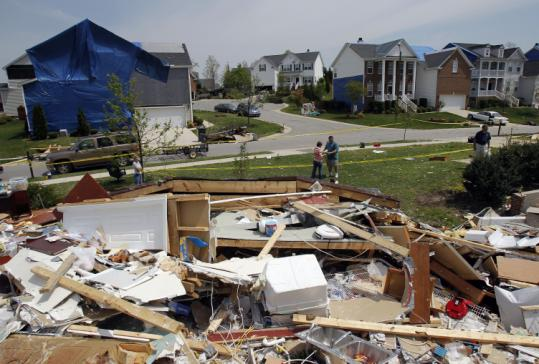 A tornado that hit Saturday devastated some homes in northeast Raleigh, N.C., and left others unscathed.