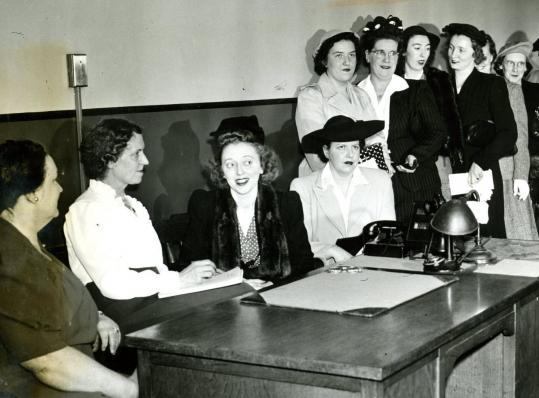 A 1943 interview for female officers. Boston's policewomen were not issued guns or uniforms until 1972.