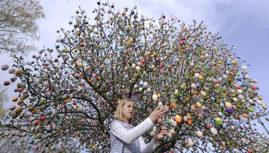 Volker Kraft's tree in Saalfeld, Germany, draws thousands of visitors from across the country to see the artfully decorated eggs.