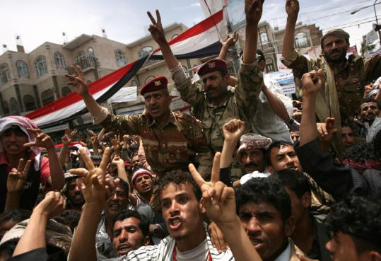 Antigovernment protesters and soldiers called for the resignation of President Ali Abdullah Saleh in Sana, Yemen, yesterday.