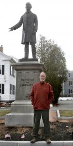 Frank Garrison in Newburyport with the statue of his great-great-grandfather.