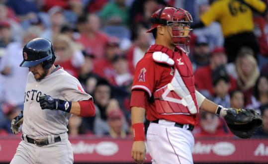 Jed Lowrie scored on Carl Crawford's single while Angels catcher Hank Conger wasn't looking.