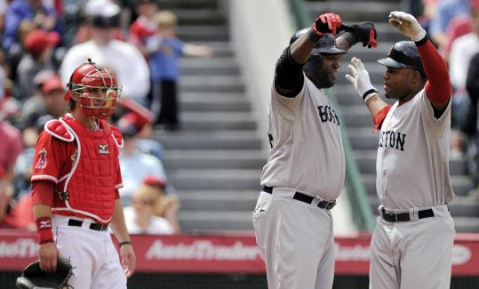 From one home run hitter to another, David Ortiz (left) congratulates Carl Crawford on his sixth inning two-run shot.
