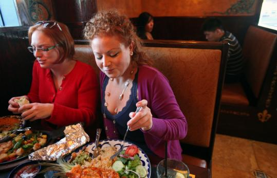 Lara Hocheiser (left) and her sister, Jen, enjoy dinner at the new La Carreta in Framingham.