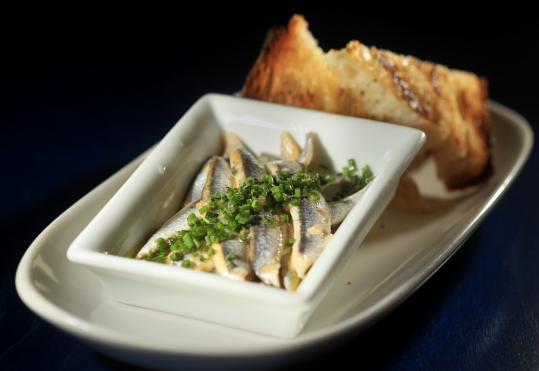 Boquerones are white anchovies marinated in vinegar.