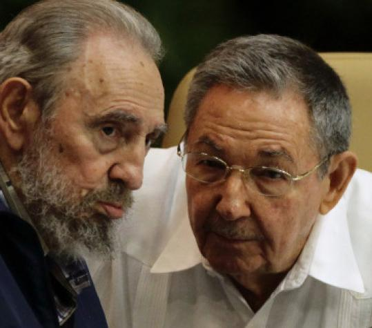 Former Cuban leader Fidel Castro and his brother, President Raul Castro, speak in Havana last week.