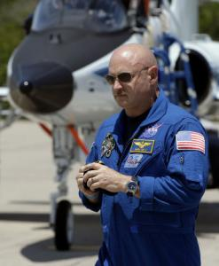 Mark Kelly took a month off from training for the launch to be with his wife immediately after the shooting in Tucson.