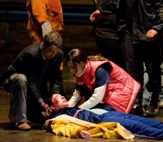 "Ricardo Darín and Martina Gusman check on a victim at a crime scene in ""Carancho.''"