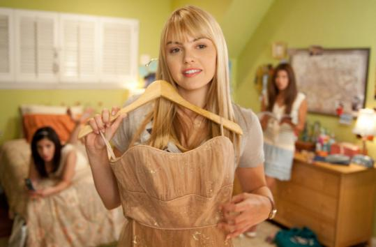 "Aimee Teegarden (pictured) and Thomas McDonell star in the sugary-sweet Disney film ""Prom.''"