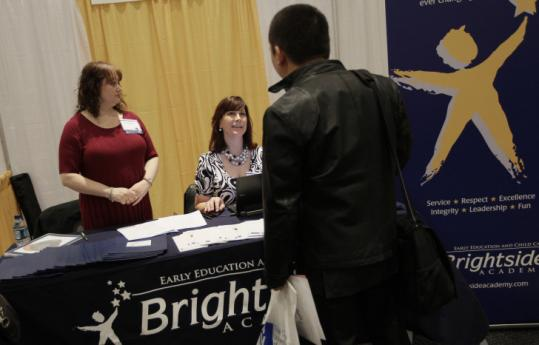 Economic growth slowed in the first three months of 2011, the Commerce Department says. Above, a New York jobs fair.