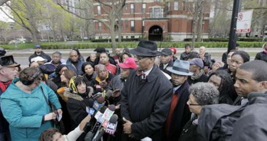 Parish council chair Isadore Glover Jr. with supporters of the Rev. Michael Pfleger, who refused to leave his Chicago parish.