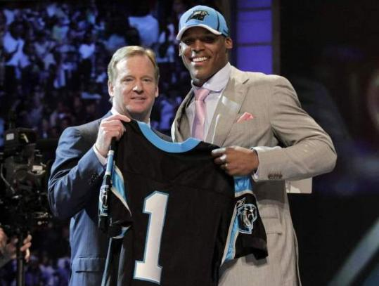 Cam Newton was the first to pose with commissioner Roger Goodell after the Panthers selected the Auburn QB No. 1.