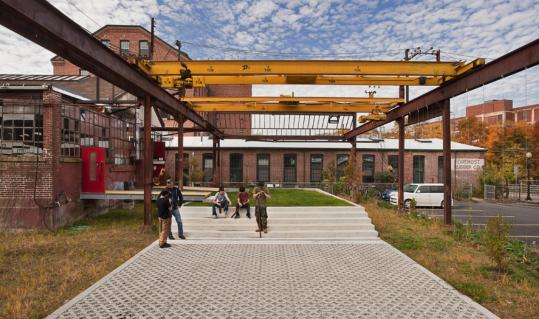 Cambridge landscape architects Mark Klopfer and Kaki Martin transformed an old steel fabricating plant into a place where artists create their own work and teach a variety of courses.