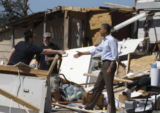 President Obama toured wreckage in Tuscaloosa, Ala., yesterday. Up to 1 million Alabama homes and businesses remained without power following Wednesday's tornado outbreak, which killed dozens of people in Tuscaloosa.