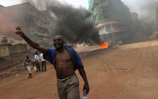 A protester shouted in Kampala yesterday. At least two people were killed after security forces fired at rioting demonstrators.