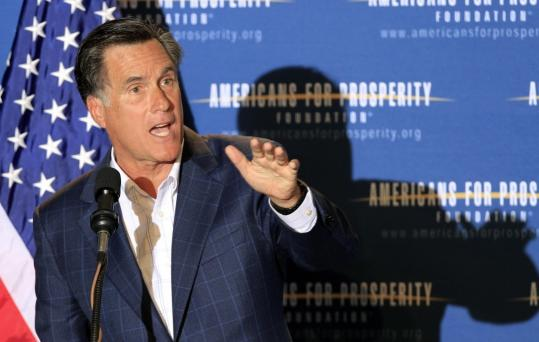 Presidential hopeful Mitt Romney, former governor of Massachusetts, spoke during a dinner sponsored by Americans for Prosperity.