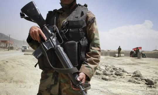 An Afghan soldier stands guard outside of an airport after a gunfire incident in Kabul last week.
