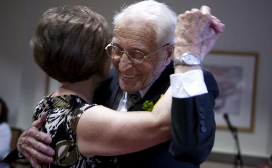 Floyd Crellin wows the crowd as he waltzes with physical therapist Mary Keohane during his 100th birthday party at Goddard House in Brookline.