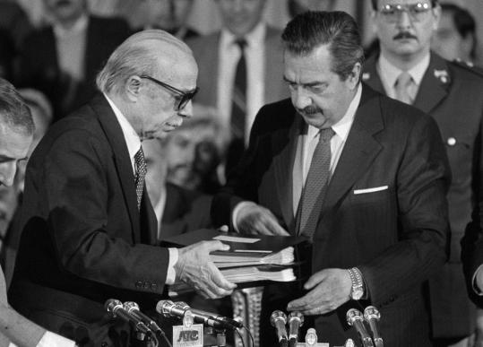 "Ernesto Sabato (left) presented his report on crimes committed by Argentina's dictatorship to President Raul Alfonsin in 1984. Mr. Sabato called his work on the report a ""descent into hell.''"