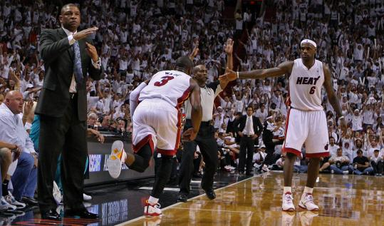 Doc Rivers calls for a timeout after Dwyane Wade (3) drilled a 3-pointer to put Miami up, 87-74.