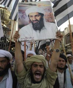 Supporters of Osama bin Laden shout anti-US slogans in Pakistan yesterday.