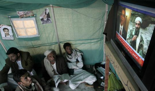 A group of men in Sana, Yemen, watched a report yesterday about the killing of Osama bin Laden in a Pakistan compound.