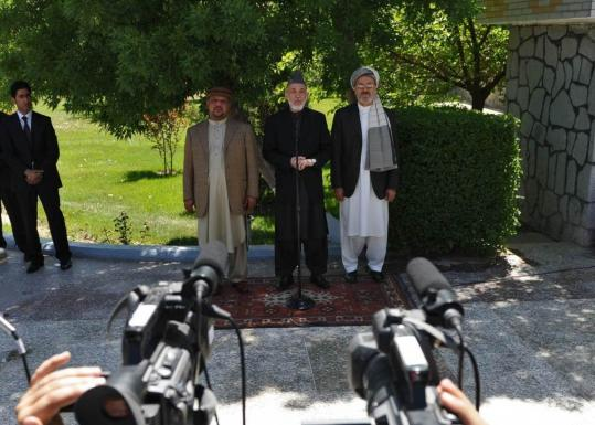 President Hamid Karzai (center) said yesterday that the killing of Osama Bin Laden in Pakistan proved Kabul's position that the war on terror was not rooted in Afghanistan.